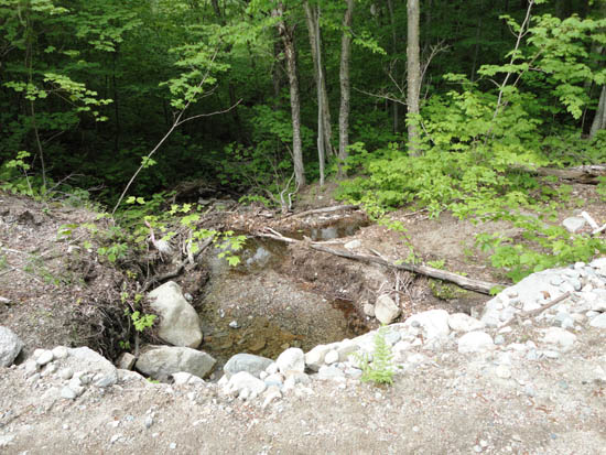Sediment in brook crossed by Mittersill base access road, June 2011