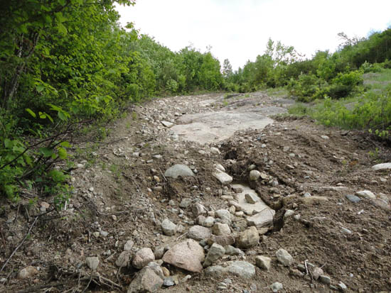 The eroded Mittersill access road, June 2011